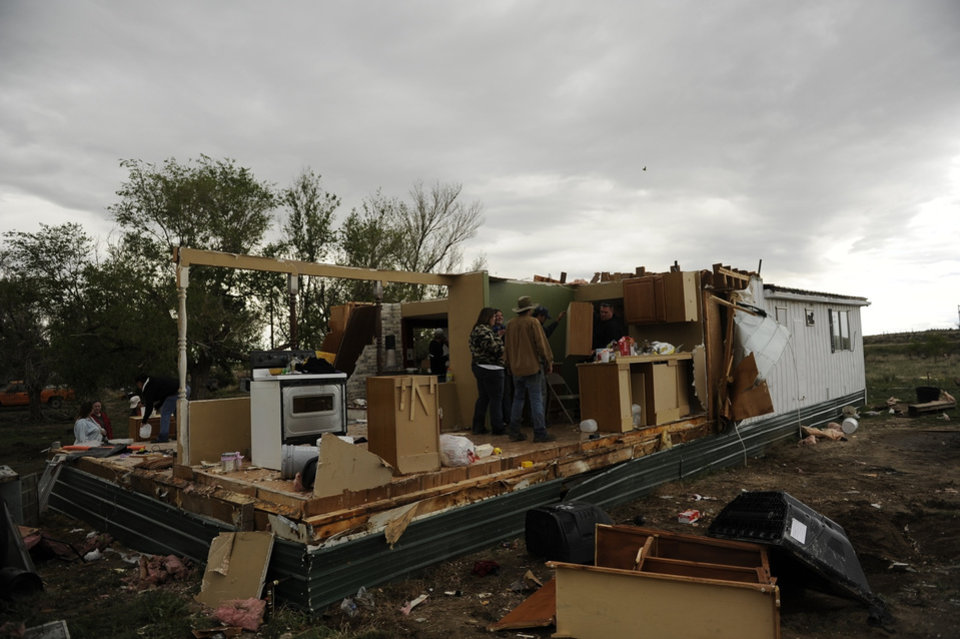 Photo -   Debris is scattered around a home that was destroyed after as many as three rare nighttime tornadoes reportedly ripped through the area on Friday, April 27, 2012 in Chivington, Colo. State authorities said tornadoes were reported in Prowers, Kiowa and Bent counties. Lamar officials in Prowers County said deputies and state troopers spotted a fast and large tornado south of the city that ripped through four homes and left at least two people with minor injuries. (AP Photo/The Denver Post, RJ Sangosti) MAGS OUT; TV OUT; INTERNET OUT