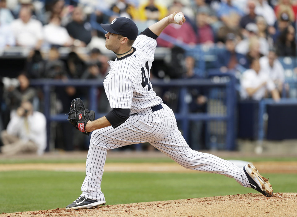 Photo - New York Yankees starting pitcher David Phelps throws a pitch during the first inning of an exhibition baseball game against the Pittsburgh Pirates Thursday, Feb. 27, 2014, in Tampa, Fla. (AP Photo/Charlie Neibergall)
