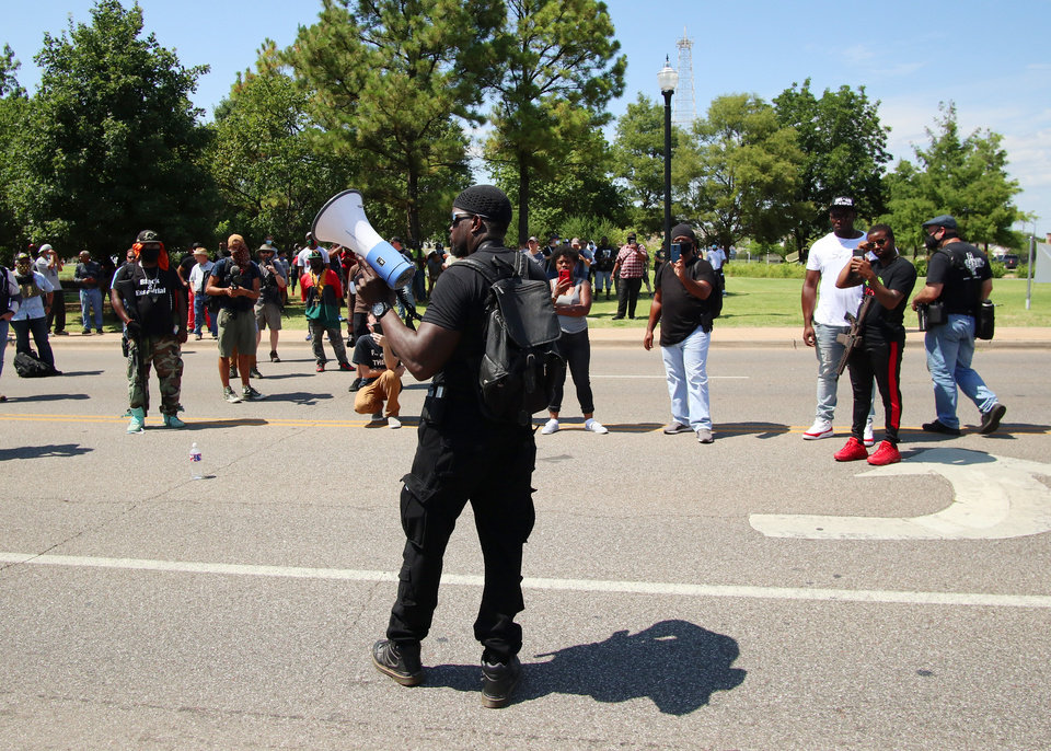 Photo - Omar Chatman speaks outside of the Governor's Mansion at a 1,000 brothers and sisters in arms for second amendment walk by predominantly black men and women to advocate for their second amendment rights, Saturday, June 20, 2020. [Doug Hoke/The Oklahoman]