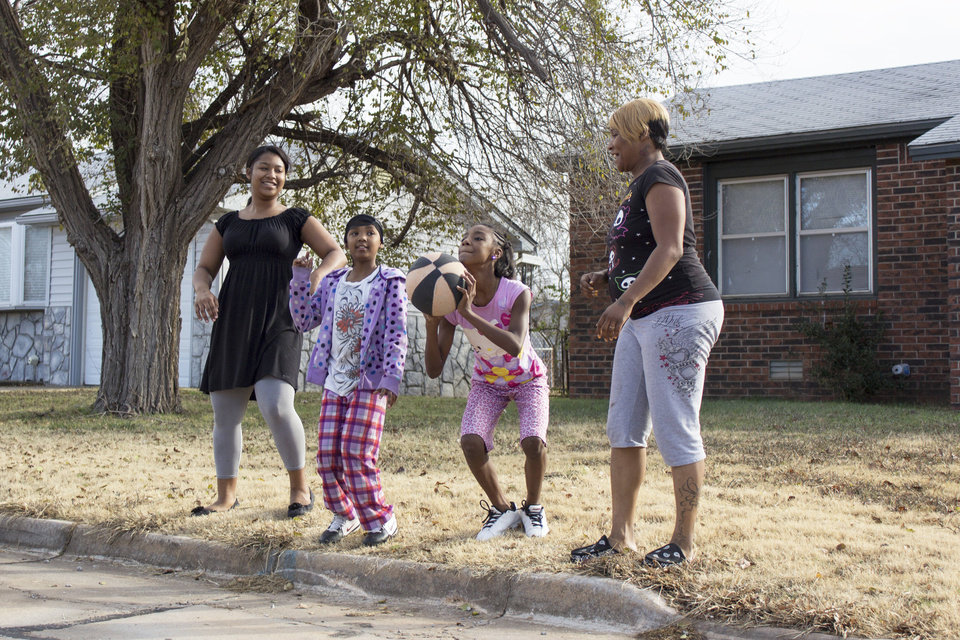 Maeahja, 14 (left), the Rogers' eldest, plays with (left to right) cousins Toriana and Ty'Sheauna Pennon and Maeisha Pennon, Keta Rogers' sister. Photo by Heather Brown for The Oklahoman  <strong></strong>