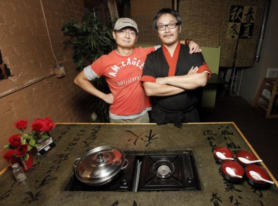 Dean Chen, left, and David Tjie pose for a photo at the Tokyo Pot, a Japanese shabu-shabu restaurant, at 108 W 10th Avenue, in Stillwater, Okla., Tuesday, September 15, 2009. Photo by Nate Billings, The Oklahoman ORG XMIT: KOD NATE BILLINGS - THE OKLAHOMAN