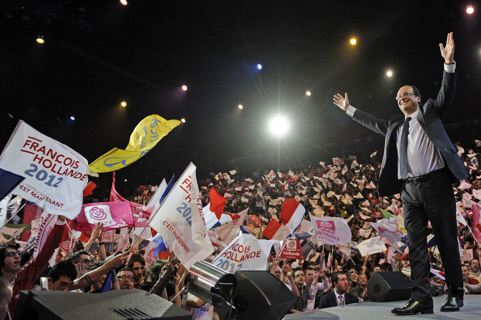 Photo -   Socialist presidential candidate for the upcoming presidential election Francois Hollande waves to supporters at the end of his electoral meeting at the Bercy stadium in Paris, Sunday April 29, 2012.(AP Photo/Fred Dufour/Pool)
