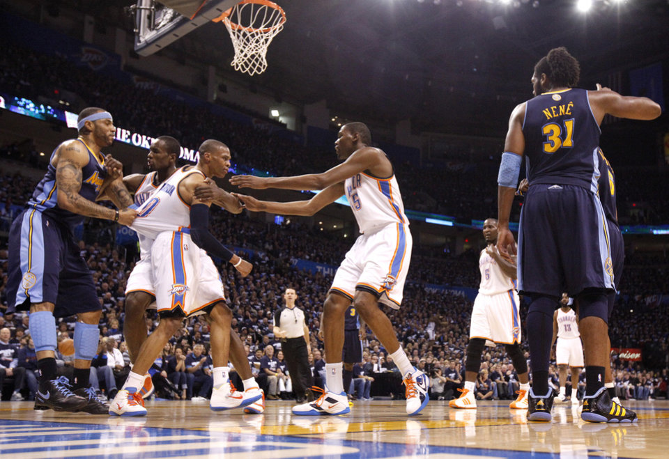 Denver's Kenyon Martin (4), Oklahoma City's Serge Ibaka (9) and Kevin Durant (35) hold Russell Westbrook (0) back after a being fouled by  Denver's Nene (31) during the NBA basketball game between the Denver Nuggets and the Oklahoma City Thunder in the first round of the NBA playoffs at the Oklahoma City Arena, Wednesday, April 27, 2011. Photo by Bryan Terry, The Oklahoman