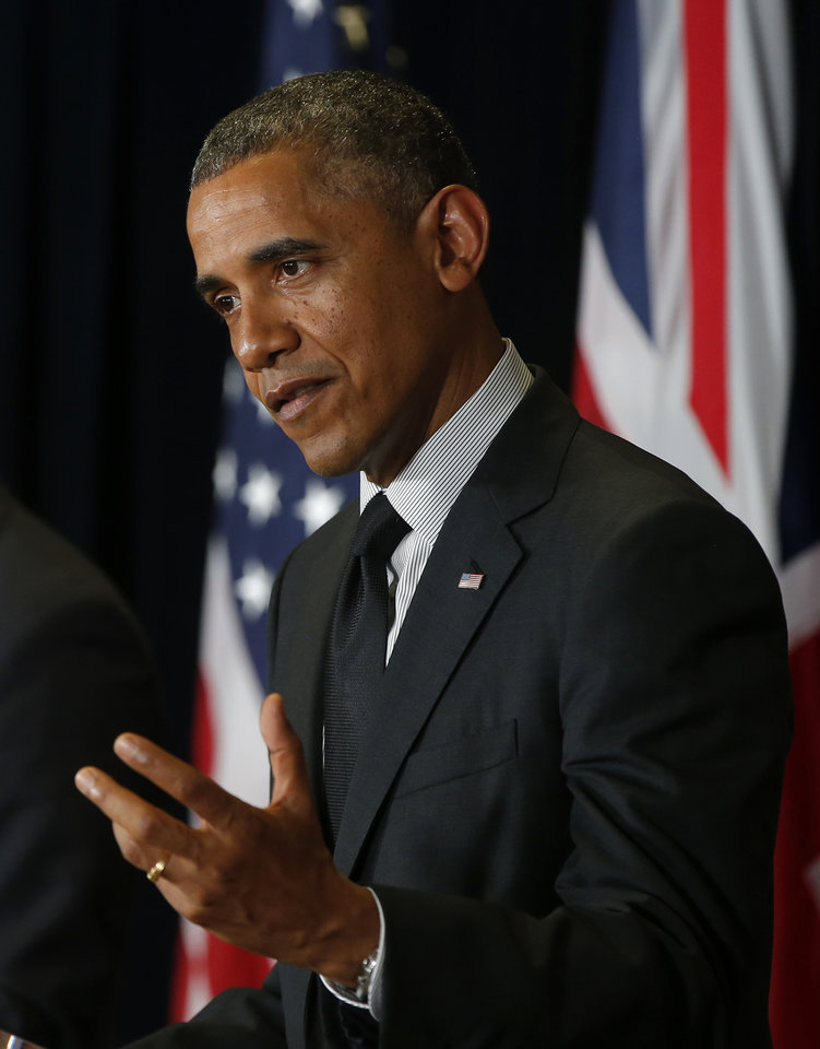 Photo - President Barack Obama speaks during a news conference with British Prime Minister David Cameron at the G7 summit in Brussels, Belgium, Thursday, June 5, 2014. (AP Photo/Charles Dharapak)