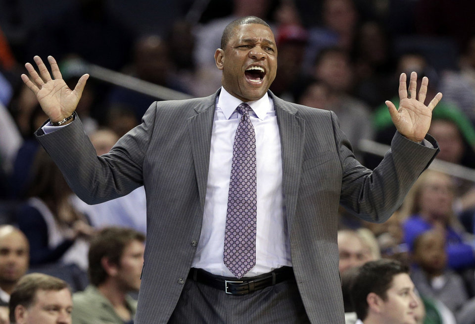 Photo - FILE - In this Feb. 11, 2013 file photo, Boston Celtics head coach Doc Rivers reacts to a call during the first half of an NBA basketball game against the Charlotte Bobcats in Charlotte, N.C. Rivers will be the next coach of the Los Angeles Clippers if the NBA approves the rare but not unprecedented trade of an active coach, a Boston Celtics official told The Associated Press on Sunday night, June 23, 2013. (AP Photo/Chuck Burton, File)