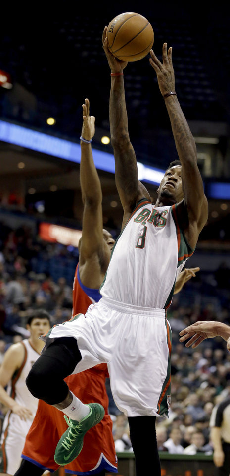 Milwaukee Bucks' Larry Sanders (8) shoots against the Philadelphia 76ers during the second half of an NBA basketball game, Tuesday, Jan. 22, 2013, in Milwaukee. (AP Photo/Jeffrey Phelps)