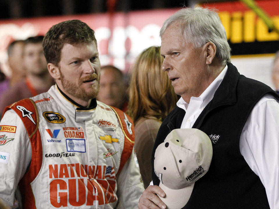 Photo - Dale Earnhardt Jr., left, talks with team owner Rick Hendrick before the first of two NASCAR Sprint Cup series qualifying auto races at Daytona International Speedway in Daytona Beach, Fla., Thursday, Feb. 20, 2014. (AP Photo/Terry Renna)