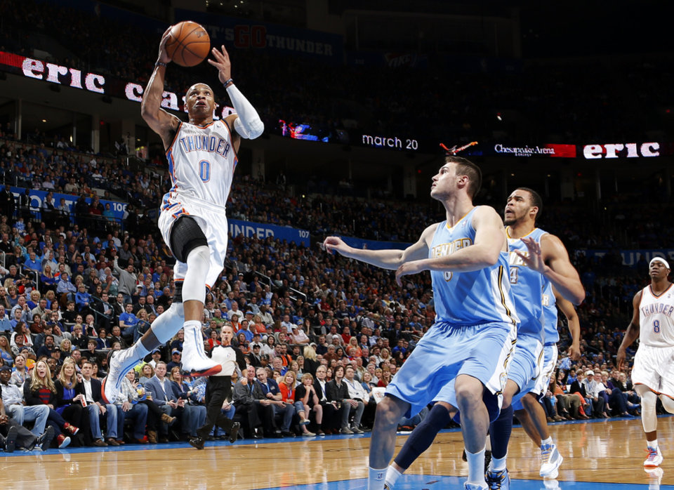 Oklahoma City\'s Russell Westbrook (0) goes past Denver\'s Danilo Gallinari (8) and JaVale McGee (34) during an NBA basketball game between the Oklahoma City Thunder and the Denver Nuggets at Chesapeake Energy Arena in Oklahoma City, Tuesday, March 19, 2013. Photo by Bryan Terry, The Oklahoman
