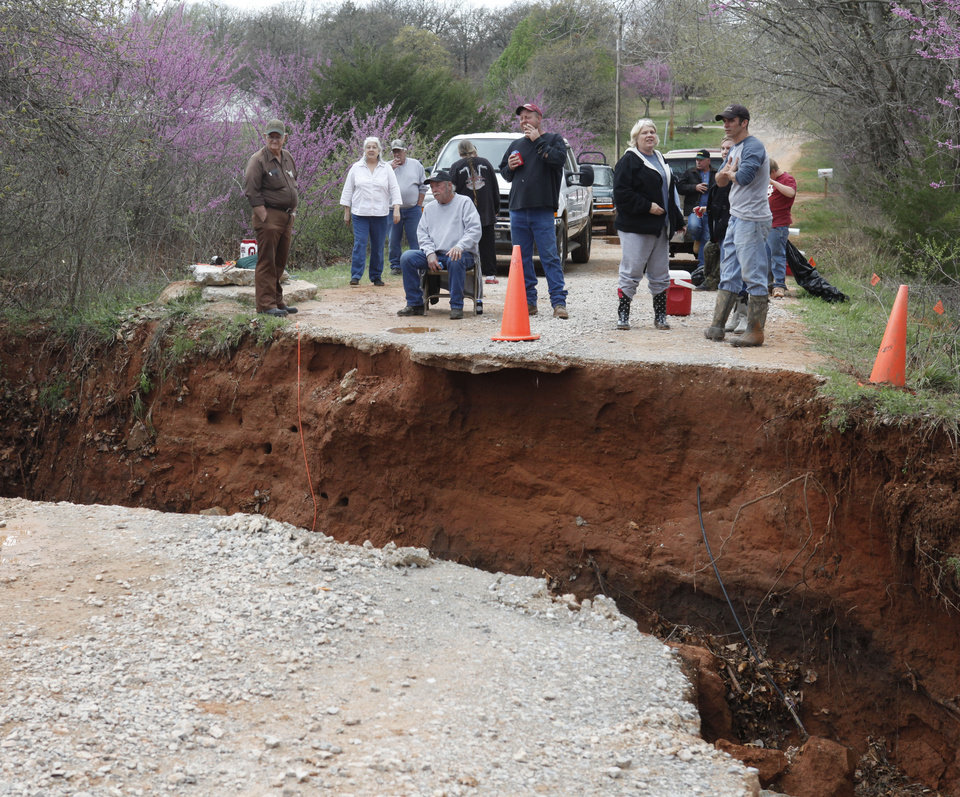 Residents sit and wait after a bridge washed out on SE 125th in Oklahoma City, OK, removing their only means of exit, Tuesday, March 20, 2012. The area is about a mile west of Harrah-Newalla Road. By Paul Hellstern, The Oklahoman