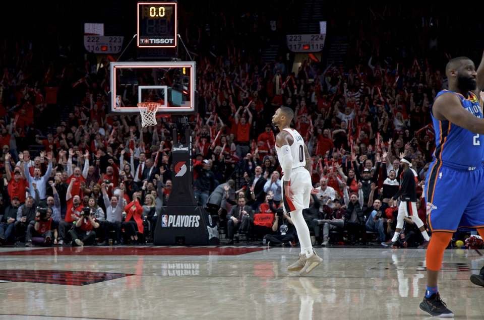 Photo - Portland Trail Blazers guard Damian Lillard reacts after making a 3-point basket against the Oklahoma City Thunder during the second half of Game 2 of an NBA basketball first-round playoff series Tuesday, April 16, 2019, in Portland, Ore. The Trail Blazers won 114-94. (AP Photo/Craig Mitchelldyer)