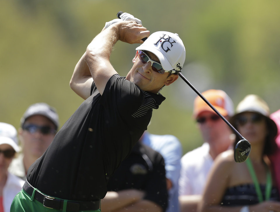 Photo - Scott Langley hits his tee shot on the second hole during the final round of the Valspar Championship golf tournament at Innisbrook, Sunday, March 16, 2014, in Palm Harbor, Fla. (AP Photo/Chris O'Meara)