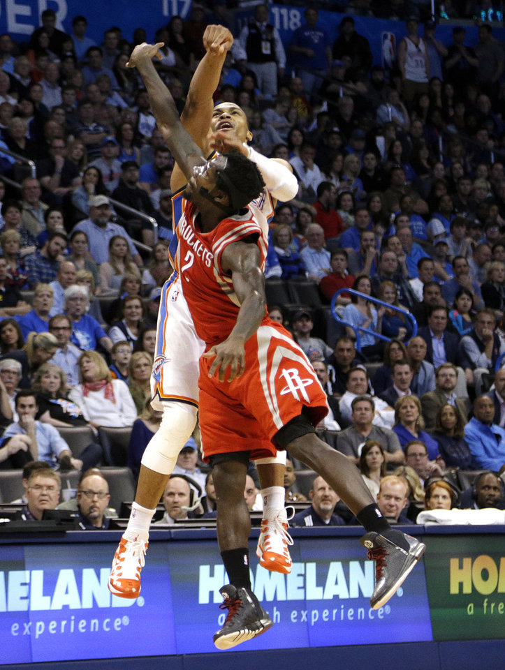 Photo - Oklahoma City's Russell Westbrook (0) is fouled by Houston's Patrick Beverley (2) during the NBA game between the Oklahoma City Thunder and Houston Rockets at the  Chesapeake Energy Arena  in Oklahoma City, Okla., Tuesday, March 11, 2014. Photo by Sarah Phipps, The Oklahoman