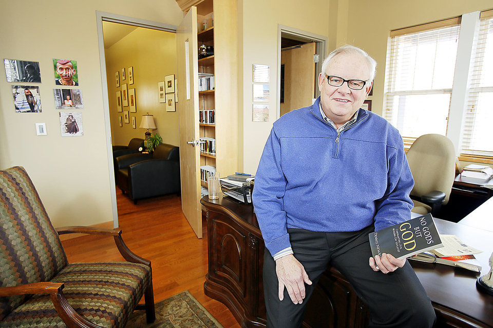 Photo - The Rev. Dennis Newkirk, senior pastor of Henderson HIlls Baptist Church, sits in his office at the Edmond church, 1200 E Interstate 35 Frontage Road.  Steve Gooch - The Oklahoman
