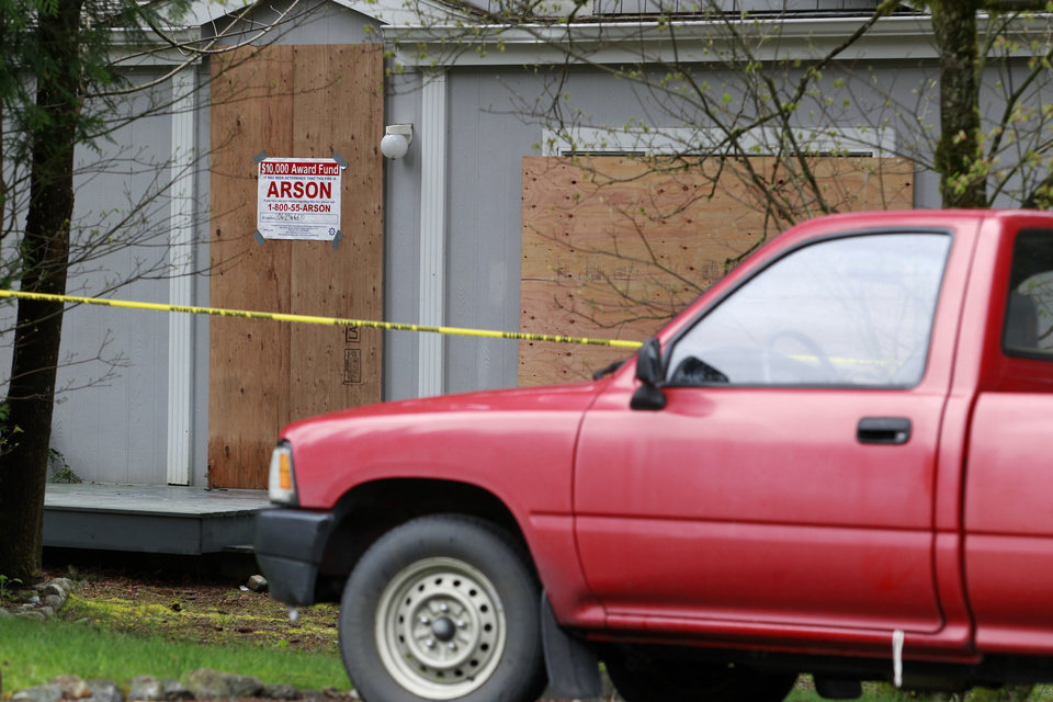 Photo -   A small pickup truck remains parked outside the burned-out home where a gun-toting survivalist is suspected of killing his wife and daughter several days earlier and then setting the house on fire Friday, April 27, 2012, in North Bend, Wash. Peter Alex Keller may be holed up in a self-made fort not far from where Seattle's outer suburbs give way to the vast recreational playground of Cascade Mountains. Police expect more people to hit the nearby trails this weekend, and deputies are warning them to steer clear of Keller if they think they see him. (AP Photo/Elaine Thompson)