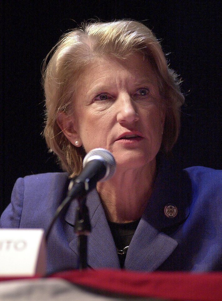 Photo - FILE - In this Oct. 13, 2004 file photo, U.S. Rep. Shelley Moore Capito, R-W.Va., speaks during a 2nd District congressional debate, in Shepherdstown, W.Va. The coal industry is shedding thousands of jobs and facing the government's most severe crackdown on carbon emissions yet. But king coal still flexes its political muscle in Kentucky and West Virginia. Capito, the Republican Party nominee in the 2014 U.S. Senate election in West Virginia, has the West Virginia Coal Association's endorsement and has hauled in $264,100 from mining interests. (AP Photo/Ron Agnir, File)