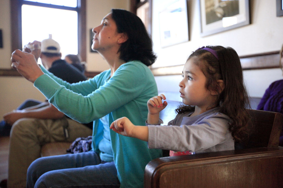 Ana Osban and Zoe Osban, 2, move to music by Ellis Paul on Sunday at a free family concert at the Santa Fe Depot in Norman. Paul's appearance was sponsored by the Performing Arts Studio, based at the depot.  PHOTOS BY SARAH PHIPPS, THE OKLAHOMAN