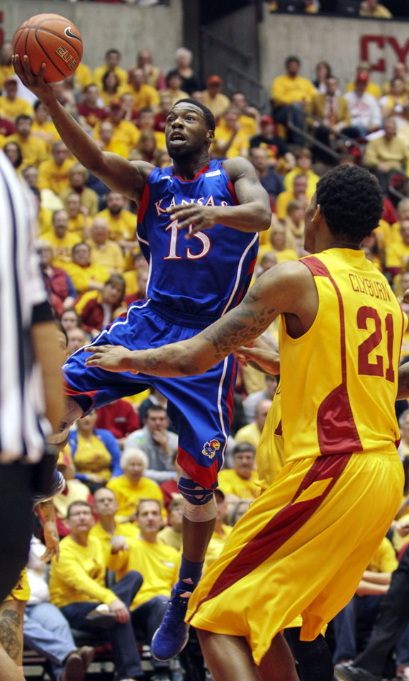 Kansas guard Elijah Johnson (15) shoots against Iowa State\'s Will Clyburn (21) during the first half of an NCAA college basketball game, Monday, Feb. 25, 2013, in Ames, Iowa. Johnson scored 39 points in their 108-96 overtime win. (AP Photo/Justin Hayworth)