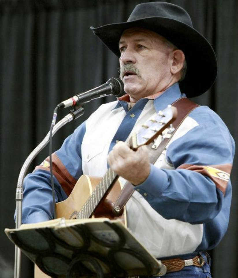 Photo - Steve Womack sings during Cowboy Church at the Oklahoma State Fair at State Fair Park in Oklahoma City on Sunday, September 18, 2011. Photo by John Clanton, The Oklahoman ORG XMIT: KOD