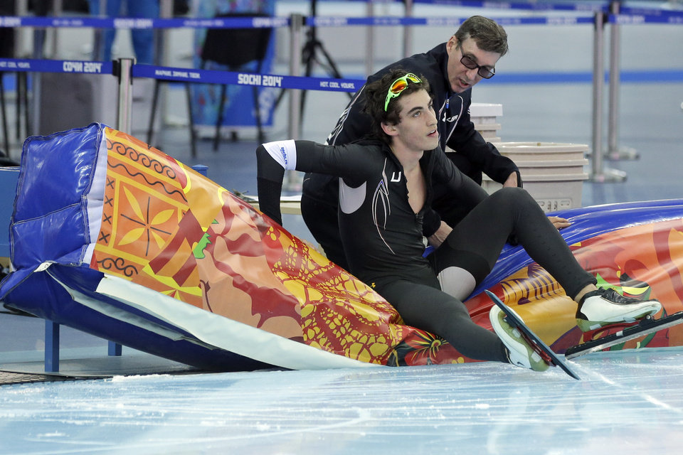 Photo - Emery Lehman of the U.S. takes a breather after competing in the men's 5,000-meter speedskating race at the Adler Arena Skating Center during the 2014 Winter Olympics, Saturday, Feb. 8, 2014, in Sochi, Russia. (AP Photo/Patrick Semansky)