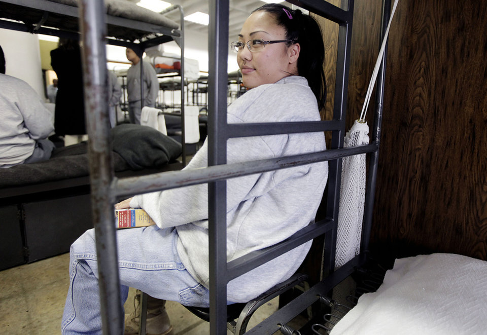 Soson Petersen sits against her bunk as she studies at Eddie Warrior Correctional Center Dec. 1, 2010. Petersen is working on her bachelor's degree. MIKE SIMONS/Tulsa World