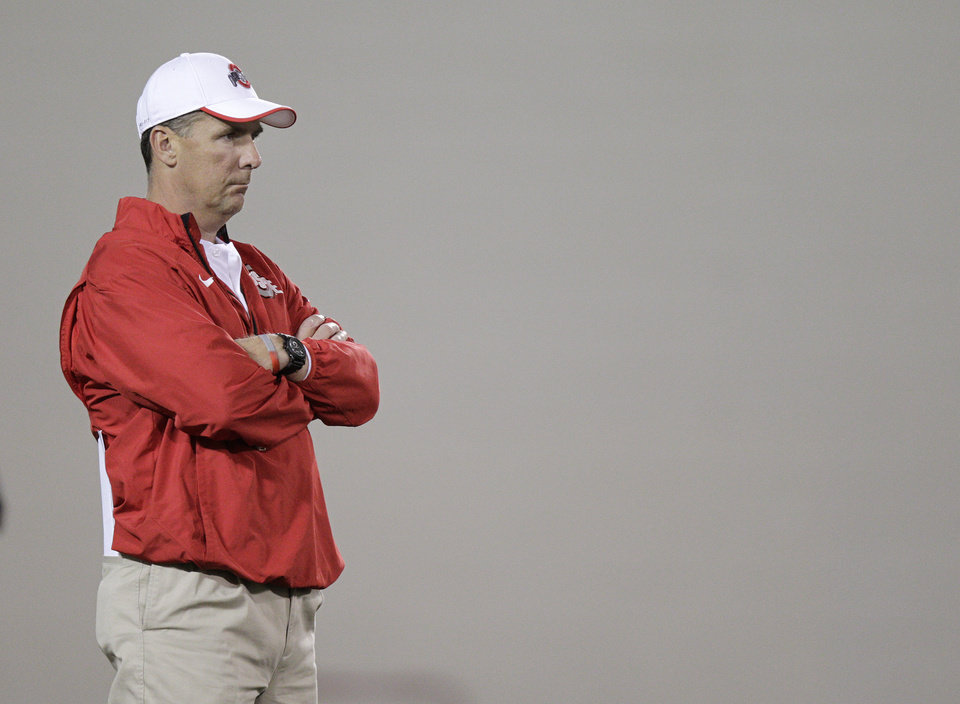 Photo - Ohio State coach Urban Meyer watches his team during NCAA college football practice Tuesday, March 4, 2014, in Columbus, Ohio. (AP Photo/Jay LaPrete)