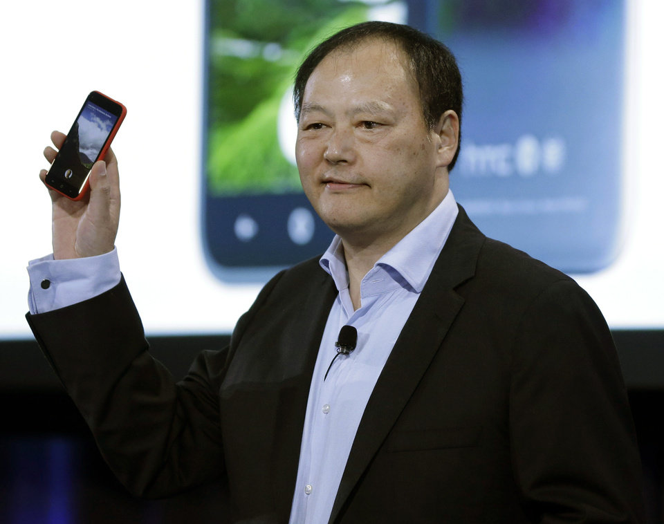 Photo - Peter Chou, CEO of HTC, displays a new phone with new Facebook interface at Facebook's headquarters in Menlo Park, Calif., Thursday, April 4, 2013. The company says it is not building a phone or an operating system. Rather, Facebook is introducing  a new experience for Android phones. The idea behind the new Home service is to bring content right to you, rather than require people to check apps on the device.   (AP Photo/Marcio Jose Sanchez)