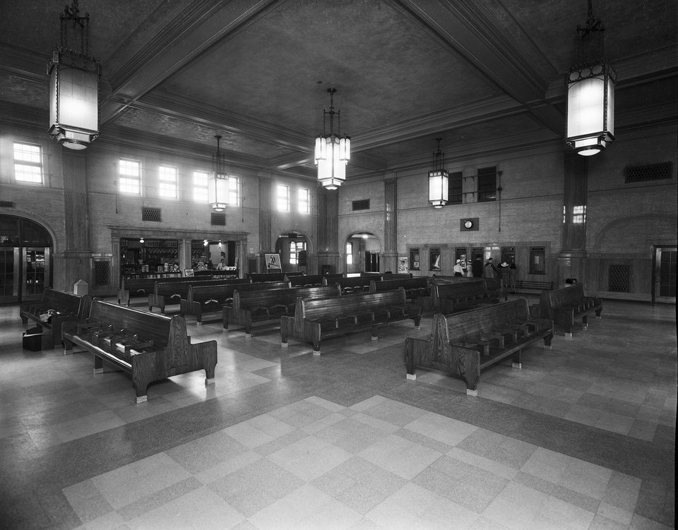 Photo -  The passenger waiting area with its 25-foot-high ceiling was restored in 1978 by Thurman Magbee and can be cleared of office pods added in the center of the area so that it can be returned to its original appearance. [Photo provided by the Oklahoma Historical Society]