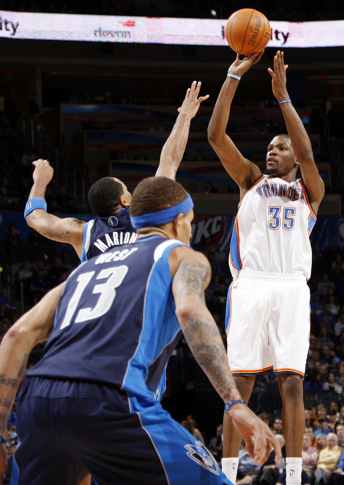 Oklahoma City's Kevin Durant (35) takes a shot over Shawn Marion (0) and Delonte West (13) of Dallas during an NBA basketball game between the Oklahoma City Thunder and the Dallas Mavericks at Chesapeake Energy Arena in Oklahoma City, Thursday, Dec. 29, 2011. Oklahoma City won, 104-102. Photo by Nate Billings, The Oklahoman