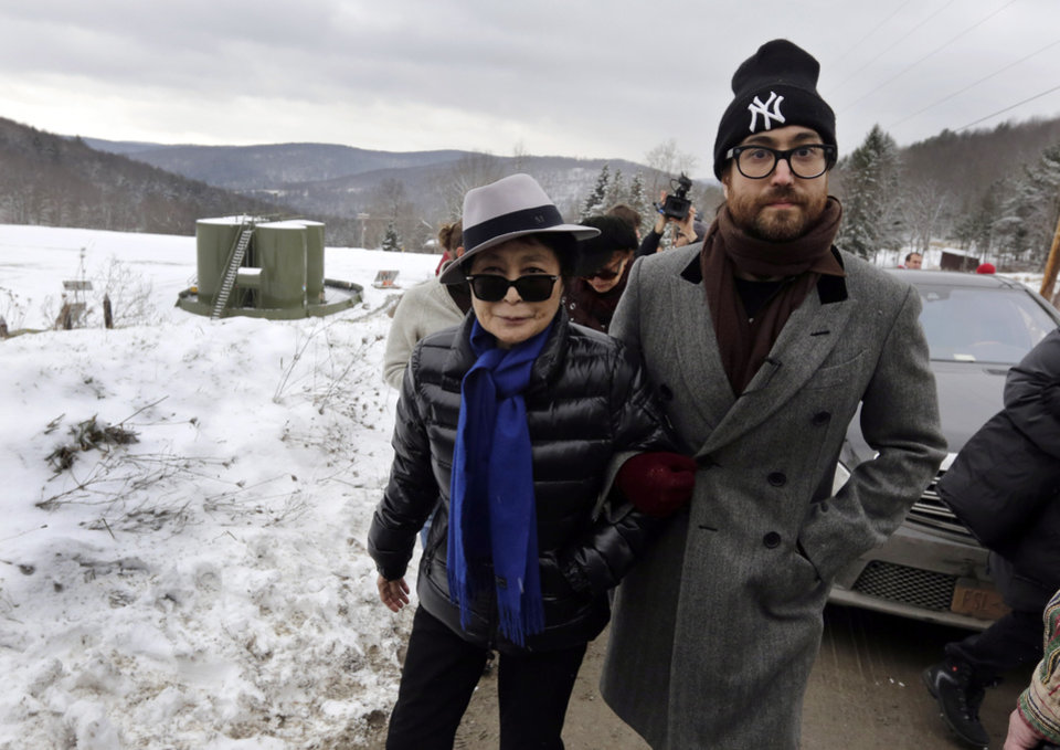 "FILE - In this file photo of Jan. 17, 2013, Yoko Ono, left, and her son Sean Lennon visit a fracking site in Franklin Forks, Pa., during a bus tour of natural-gas drilling sites in northeastern Pennsylvania. Ono and Lennon have formed a group called ""Artists Against Fracking,"" which has become the main celebrity driven anti-fracking organization. A formal complaint filed with New York's lobbying board asks it to investigate whether Artists Against Fracking is violating the state's lobbying law, according to the document obtained by The Associated Press. (AP Photo/Richard Drew, File)"