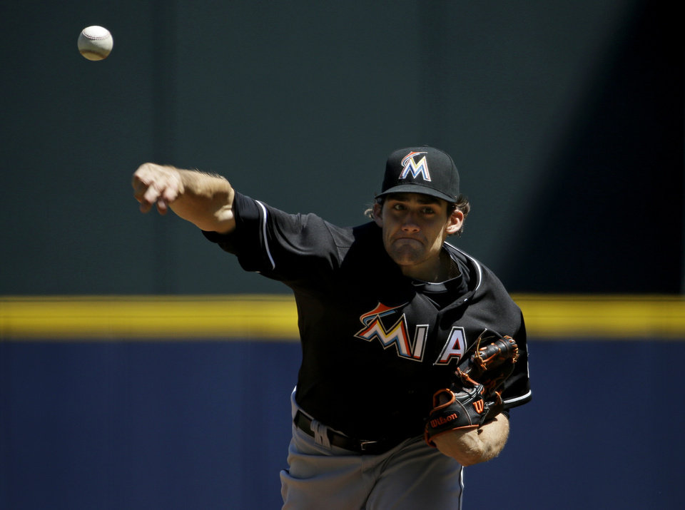 Photo - Miami Marlins starting pitcher Nate Eovaldi throws in the first inning of a baseball game against the Atlanta Braves, Wednesday, April 23, 2014, in Atlanta. (AP Photo/David Goldman)