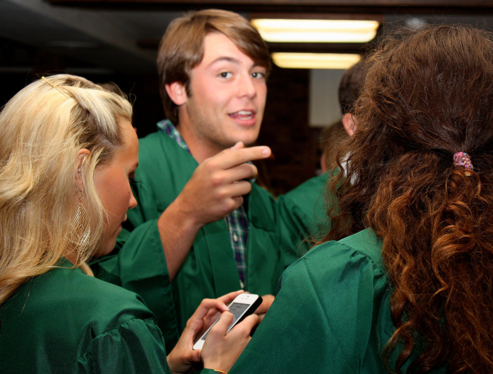 Photo -  Norman North High School senior Zach Neighbors chats with friends before a baccalaureate service for Norman North and Norman High School graduating seniors at First Baptist Church. PHOTO BY LYNETTE LOBBAN, FOR THE OKLAHOMAN