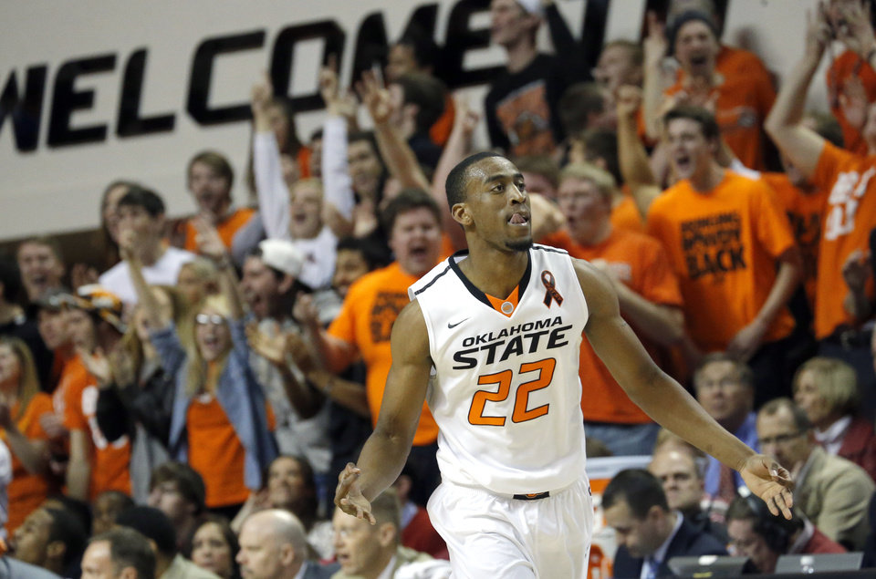 Photo - Oklahoma State's Markel Brown (22) celebrates a three-pointer during the Bedlam men's college basketball game between the Oklahoma State University Cowboys and the University of Oklahoma Sooners at Gallagher-Iba Arena in Stillwater, Okla., Saturday, Feb. 16, 2013. Photo by Sarah Phipps, The Oklahoman