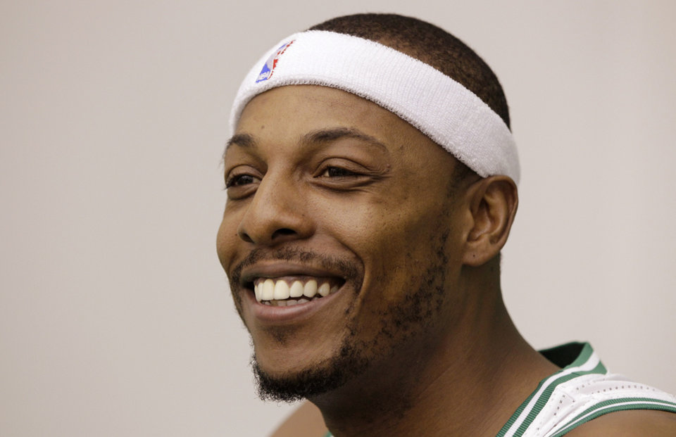 Photo -   Boston Celtic forward Paul Pierce smiles as he answers reporter's questions during media day at the NBA basketball team's training center in Waltham, Friday, Sept. 28, 2012. (AP Photo/Stephan Savoia)