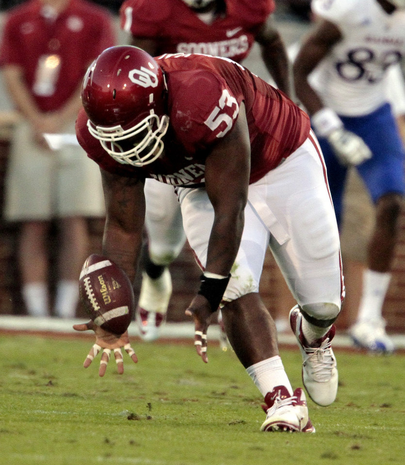 Photo - Oklahoma Sooner Casey Walker (53) recovers a fumble during the college football game between the University of Oklahoma Sooners (OU) and the University of Kansas Jayhawks (KU) at Gaylord Family-Oklahoma Memorial Stadium in Norman, Okla., on Saturday, Oct. 20, 2012. Photo by Steve Sisney, The Oklahoman