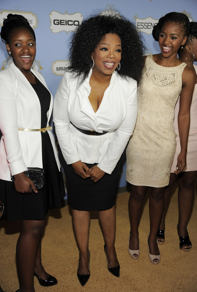 Photo - Honoree Oprah Winfrey poses with students from her Oprah Winfrey Leadership Academy for Girls in South Africa at the 6th Annual Black Women in Hollywood Luncheon at the Beverly Hills Hotel on Thursday, Feb. 21, 2013 in Los Angeles. (Photo by Chris Pizzello/Invision/AP)