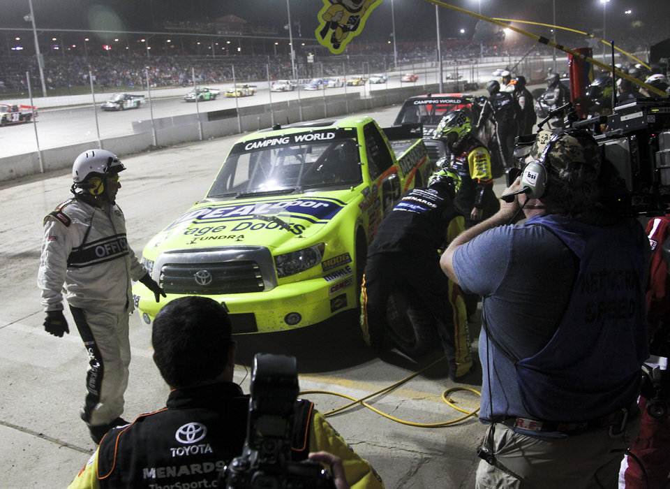 Photo - Matt Crafton makes a pit stop during the NASCAR Truck Series auto race Wednesday, July 24, 2013, on the dirt at Eldora Speedway in Rossburg, Ohio. (AP Photo/Dayton Daily News, Greg Lynch) LOCAL PRINT OUT AND LOCAL TV OUT (WKEF, WRGT, WDTN)