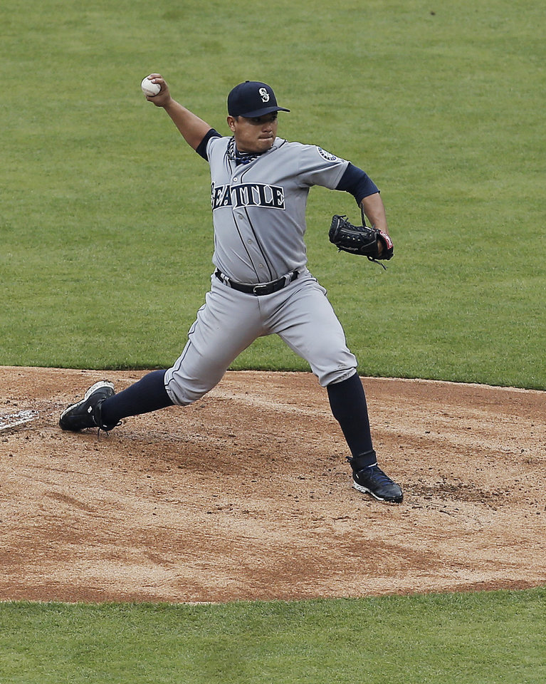 Photo - Seattle Mariners starting pitcher Erasmo Ramirez (50) throws during the first inning of a baseball game against the Texas Rangers, Thursday, April 17, 2014, in Arlington, Texas. (AP Photo/Brandon Wade)