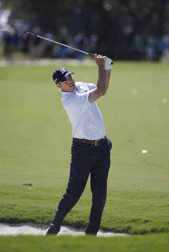 Photo - Matt Kuchar hits from the fifth fairway during the second round of the Cadillac Championship golf tournament on Friday, March 7, 2014, in Doral, Fla. (AP Photo/Lynne Sladky)