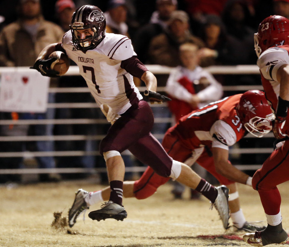 Photo - Nowata's Billy Davis scores on a pass play as the Nowata Ironmen play the Washington Warriors in high school football on Friday, Nov. 28, 2014 in Washington, Okla. Photo by Steve Sisney, The Oklahoman