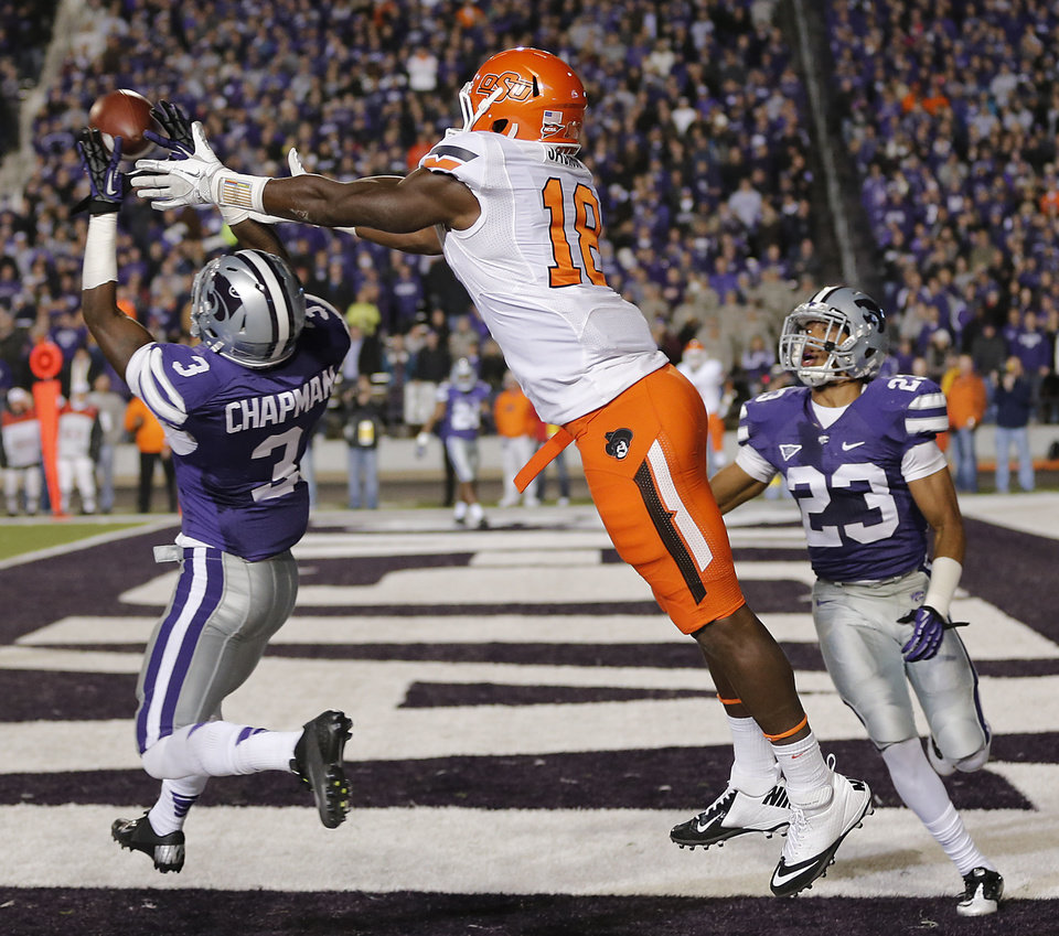 Photo - Kansas State's Allen Chapman (3) intercepts a pass for Oklahoma State's Blake Jackson (18) in the end zone during the college football game between the Oklahoma State University Cowboys (OSU) and the Kansas State University Wildcats (KSU) at Bill Snyder Family Football Stadium on Saturday, Nov. 1, 2012, in Manhattan, Kan. Photo by Chris Landsberger, The Oklahoman