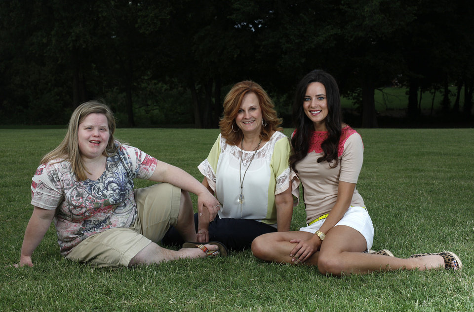 Photo - Lisa Hancock, center, poses for a photo with her daughters, Heather (left) and Jennifer.  Photo by Garett Fisbeck, The Oklahoman  Garett Fisbeck - Garett Fisbeck