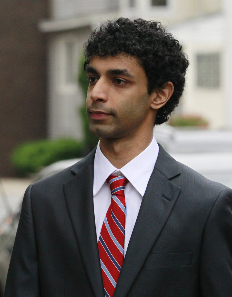 FILE - In this May 23, 2011 photo, Dharun Ravi walks into the Middlesex County Courthouse for a hearing in the webcam-spying case involving the suicide of Rutgers University student Tyler Clementi in New Brunswick, N.J. Ravi , the former Rutgers University student, is accused of spying on a roommate who later killed himself is due back in court Friday, Sept. 9, 2011 to see if he can get charges dropped. Charges against 19-year-old Dharun Ravi include privacy invasion and a hate crime. (AP Photo/Julio Cortez)