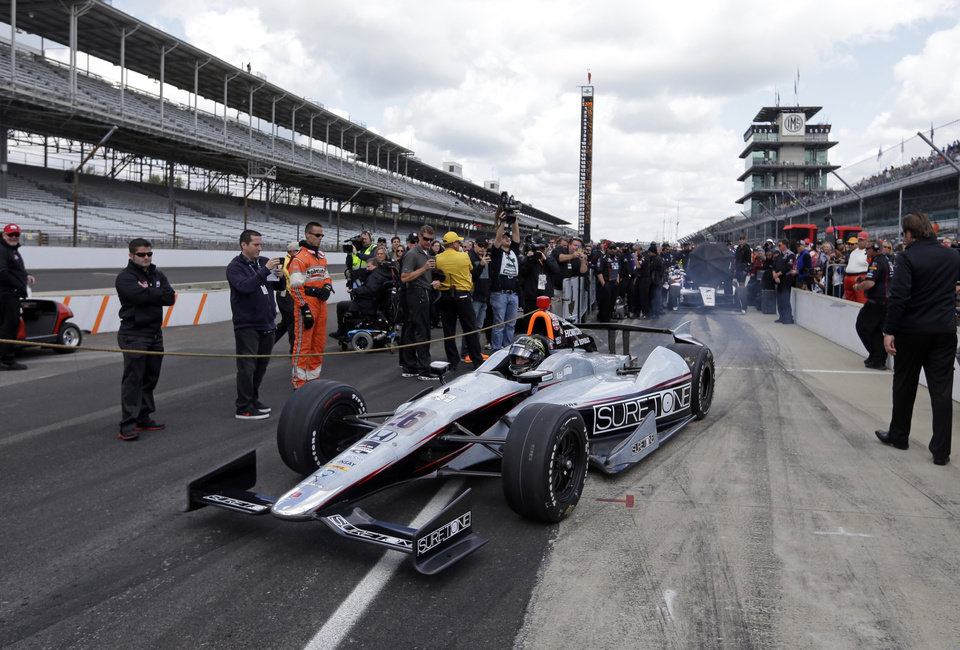 Photo - Driver Kurt Busch heads on to the track to begin his qualification attempt on the first day of qualifications for Indianapolis 500 IndyCar auto race at the Indianapolis Motor Speedway in Indianapolis, Saturday, May 17, 2014. (AP Photo/Darron Cummings)