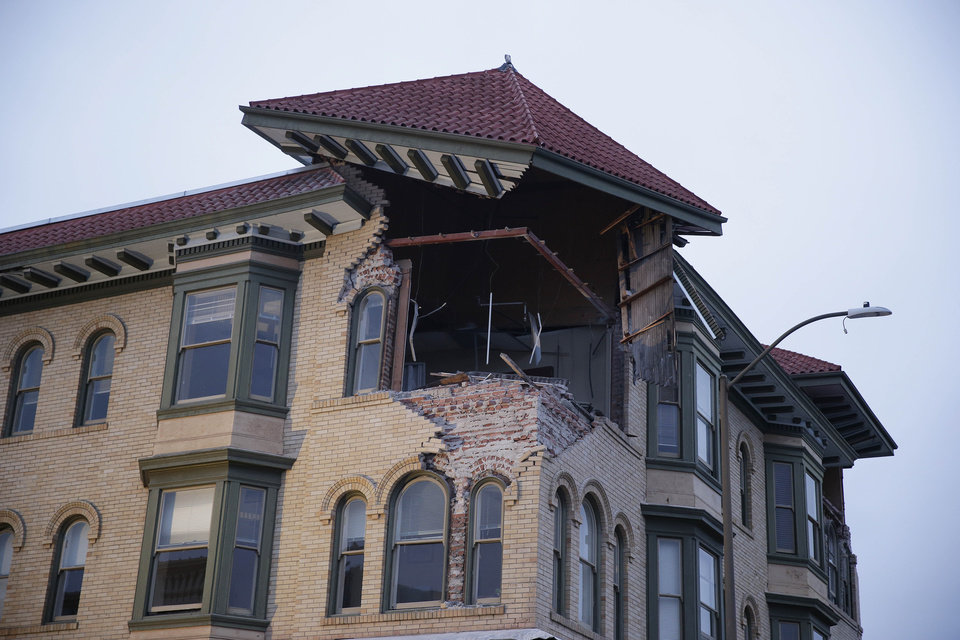 Photo - The top corner of a building is exposed following an earthquake Sunday, Aug. 24, 2014, in Napa, Calif. A large earthquake rolled through California's northern Bay Area early Sunday, damaging some buildings, igniting fires, knocking out power to tens of thousands and sending residents running out of their homes in the darkness.(AP Photo/Eric Risberg)