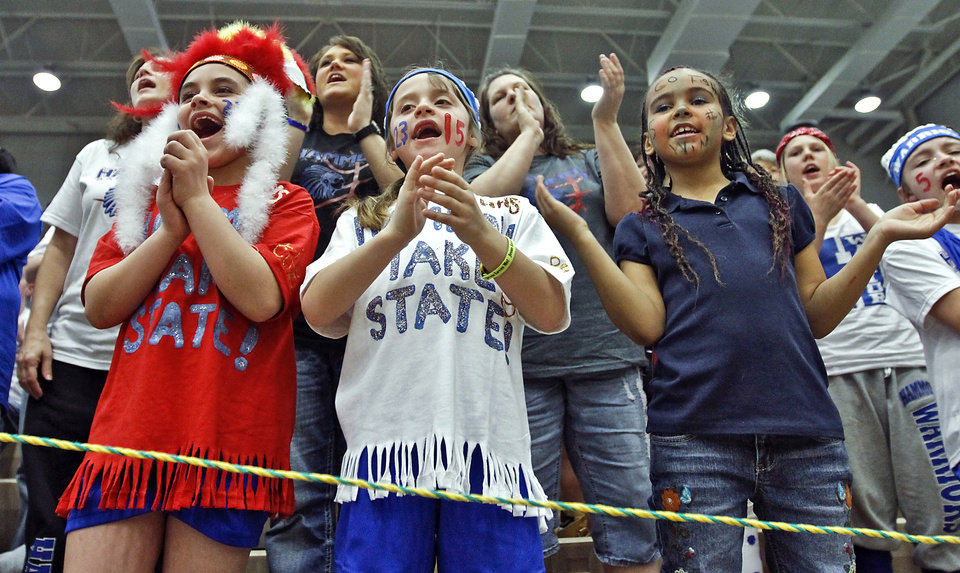 Photo - Jolie Walker, Addison Walker and Tiela Johnson, from left, cheer on Hammon during the Class B Girls State Basketball Championship game between Hammon and Arnett on Thursday, March 1, 2012 in Choctaw, Okla.  Photo by Chris Landsberger, The Oklahoman