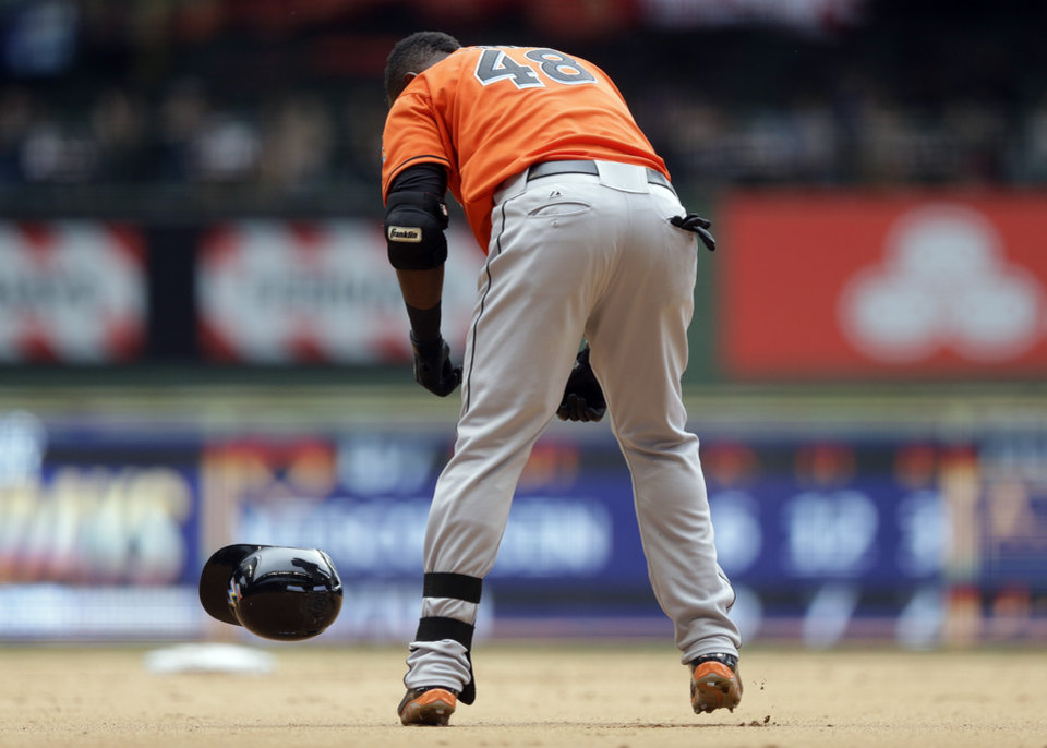 Miami Marlins' Marcell Ozuna reacts after flying out during the ninth inning of a baseball game against the Milwaukee Brewers, Sunday, July 21, 2013, in Milwaukee. (AP Photo/Morry Gash)