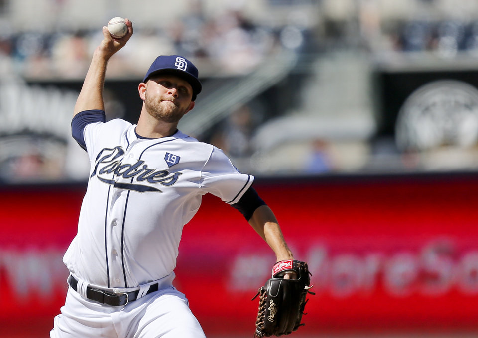 Photo - San Diego Padres starting pitcher Jesse Hahn throws against the Seattle Mariners in the first inning of a baseball game, Thursday, June 19, 2014, in San Diego. (AP Photo/Lenny Ignelzi)