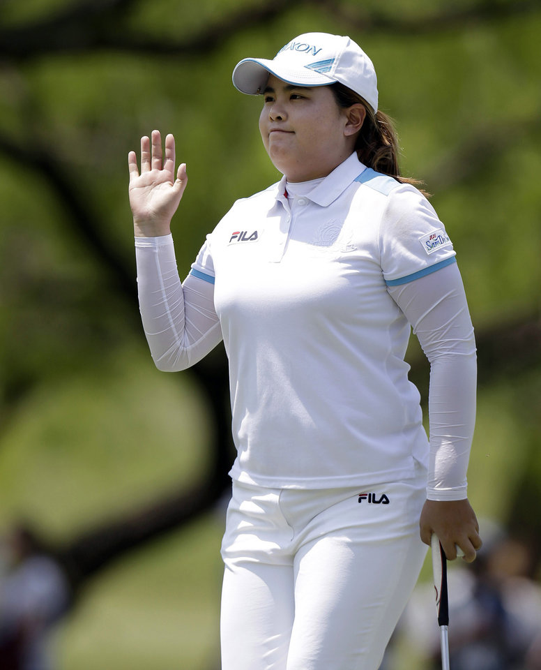 Inbee Park, of South Korea, waves to the gallery after sinking a birdie putt on the first hole during the final round of the North Texas LPGA Shootout golf tournament on Sunday, April 28, 2013, at Los Colinas Country Club in Irving, Texas. (AP Photo/LM Otero)