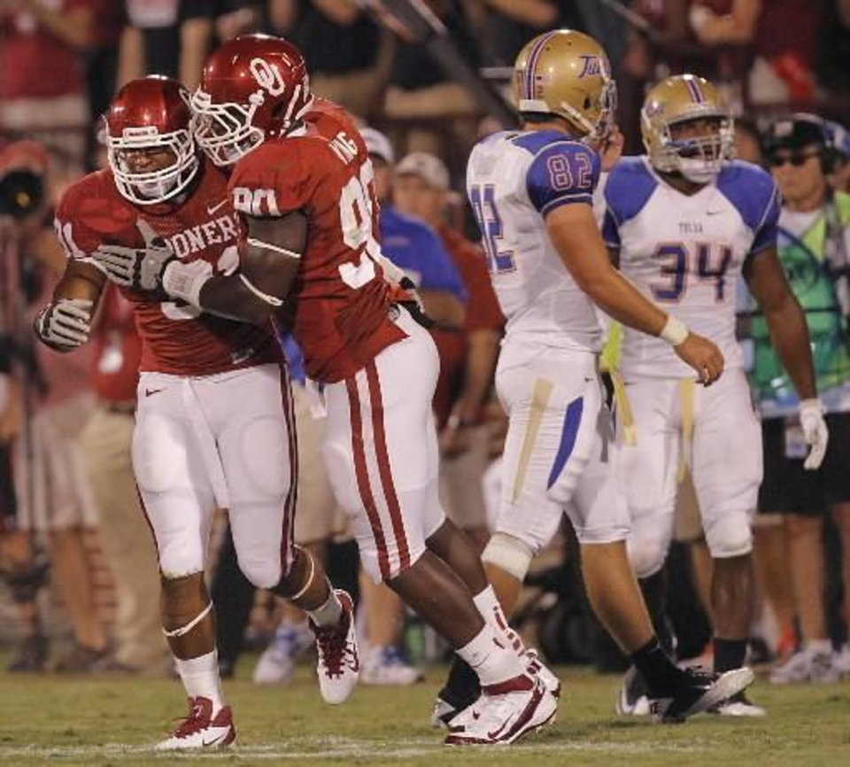 Oklahoma's R.J. Washington (91) and David King (90) celebrate after Washington's sack on Tulsa quarterback G.J. Kinne during the college football game between the University of Oklahoma Sooners ( OU) and the Tulsa University Hurricanes (TU) at the Gaylord Family-Memorial Stadium on Saturday, Sept. 3, 2011, in Norman, Okla. Photo by Chris Landsberger, The Oklahoman ORG XMIT: KOD