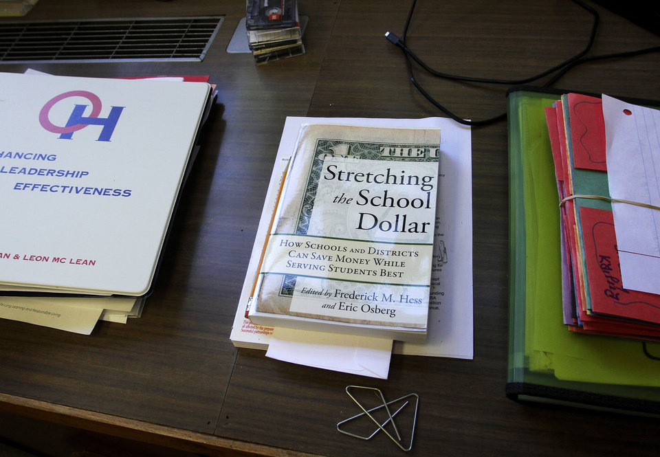 Photo - OKLAHOMA CITY PUBLIC SCHOOLS SUPERINTENDENT: Items on a book shelf in the office of Karl Springer, OKC Public Schools superintendent, on Wednesday, July 25, 2012.  Photo by Jim Beckel, The Oklahoman.